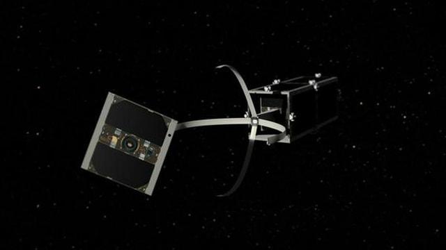 Ein Satelit mit vier Greifarmen.