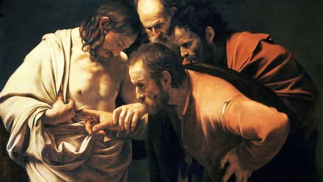 Auf einem Ölgemälde sieht man links Jesus mit halb entblösstem Oberkörper, Thomas greift mit einem Finger in dessen Wunde.