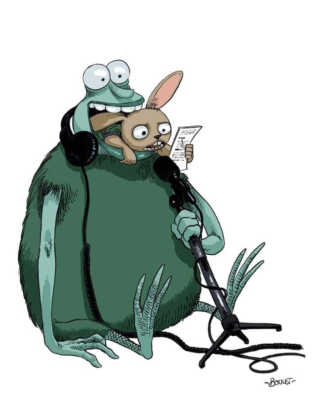 Das Monster Nubbel hat ein anderes Monster im Mund, das in ein Mikro spricht.