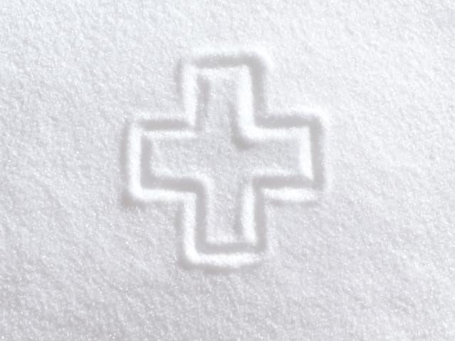 Screenshot aus Werbung für Schweizer Zucker (Schweizerkreuz in Zucker gemalt)