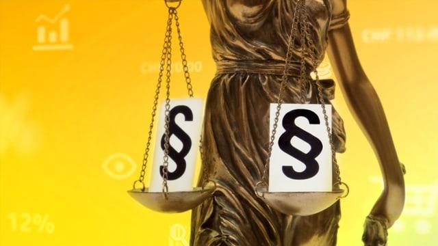 Justicia mit einem Paragrahensymbol auf der Waage