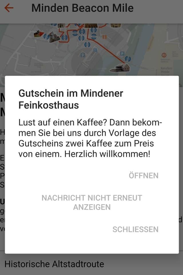 Screenshot der Minden App: Gutschein für zwei Kaffee zum Preis von einem im Mindener Feinkosthaus.