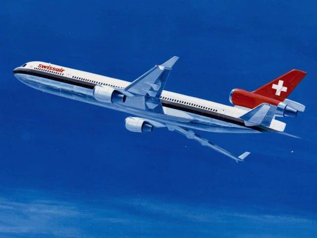 Ein Swissair-Flugzeug in der Luft.