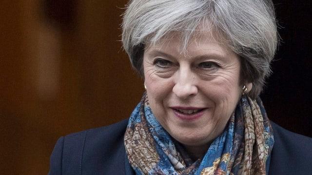 Il maletg mussa la primministra britannica Theresa May
