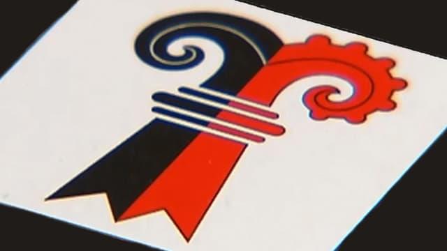 Ein Kantonswappen mit einem Doppelstab, das die Wappen von BS und BL vereint.