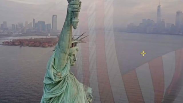Überblendung Freiheitsstatue auf US-Fahne