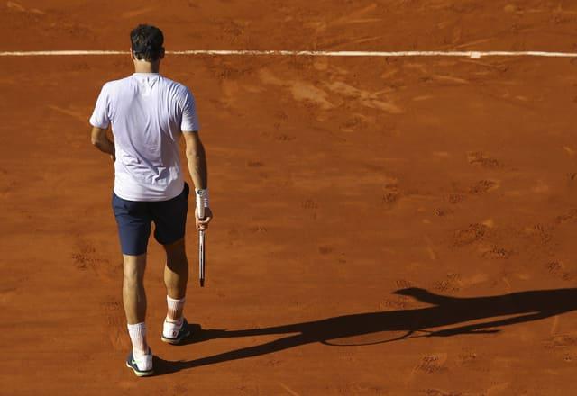 Roger Federer auf sandiger Unterlage