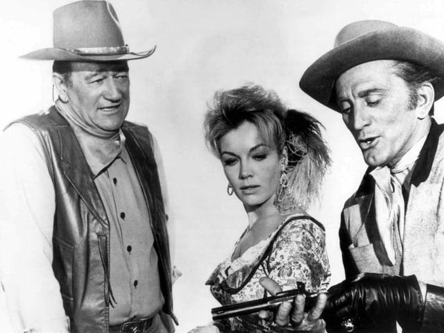 Johne Wayne, Joanna Barnes und Kirk Douglas