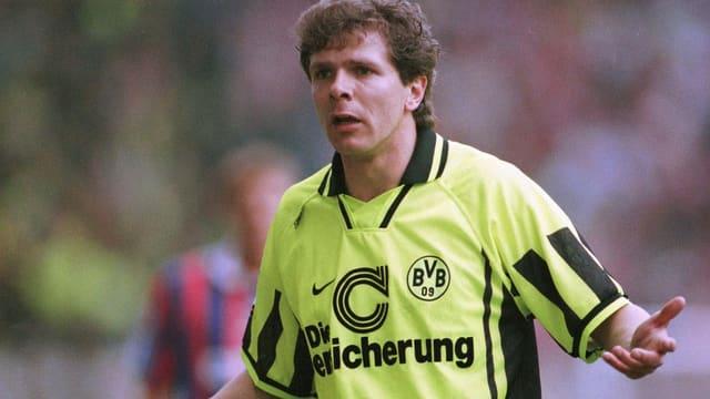Andreas Möller mit gelbem T-Shirt auf dem Fussballplatz