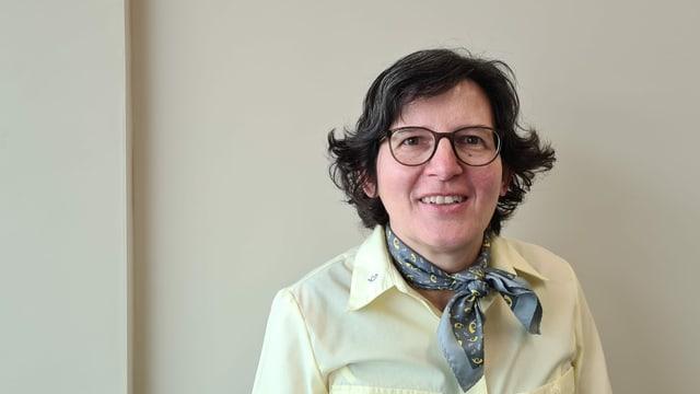 Carmelia Arias Linares lavura dapi passa 20 onns per l'AutoDaPosta a Glion.