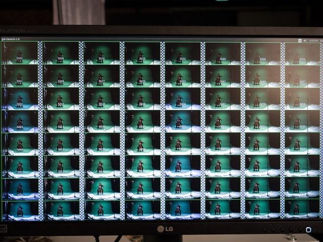Ein grosser Monitor, darauf 8 mal 8 briefmarkengrosse Bildchen, das die Sicht jeder Kamera zeigt.