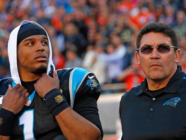 Cam Newton und Coach Ron Rivera