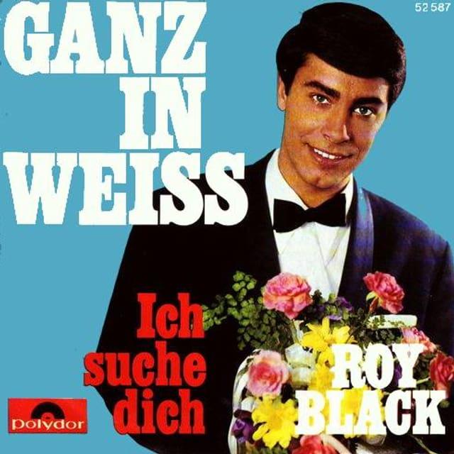 Platten-Cover «Ganz in Weiss» mit dem jungen Roy Black, der einen Strauss bunter Blumen in den Händen hält.