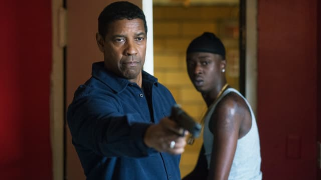 Afroamerikaner mit Waffe.