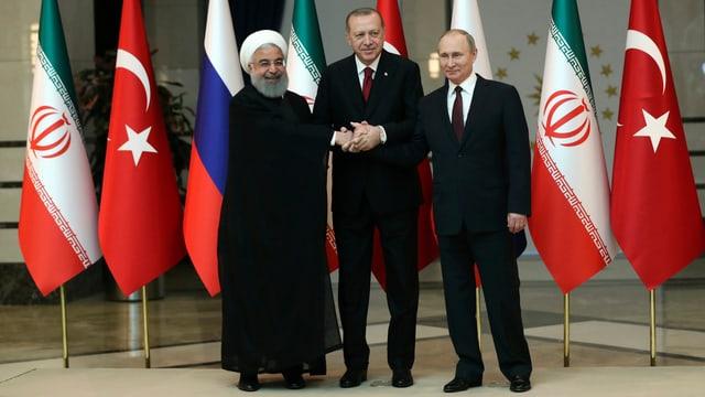 Hassan Rohani (links), Recep Tayyip Erdogan (Bildmitte) und Wladimir Putin (rechts).