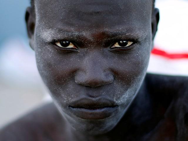 Migrant bei seiner Festsetzung an der libyischen Küste