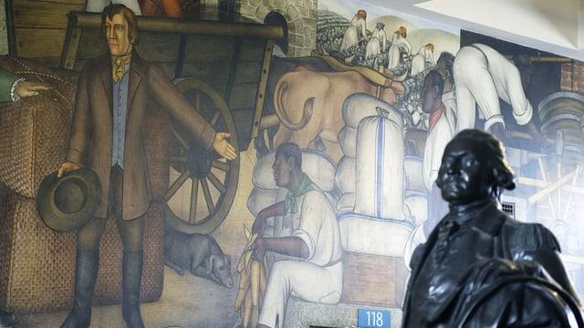 Malerei an der Wand: ein Mann zeigt auf einen Sklaven.