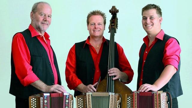 Drei Männer mit Schwyzerörgeli und Kontrabass.