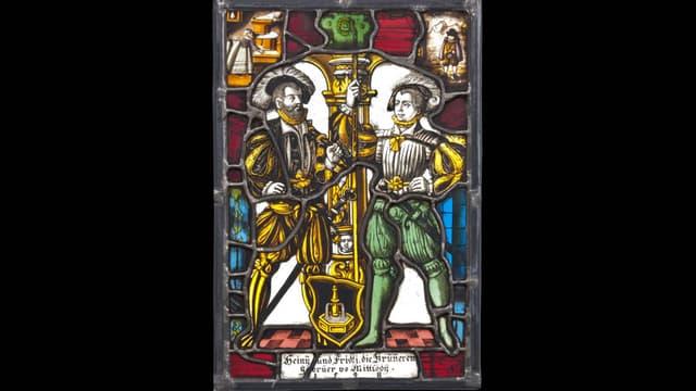 Wappenscheibe mit detaillierten Bildern in den Ecken