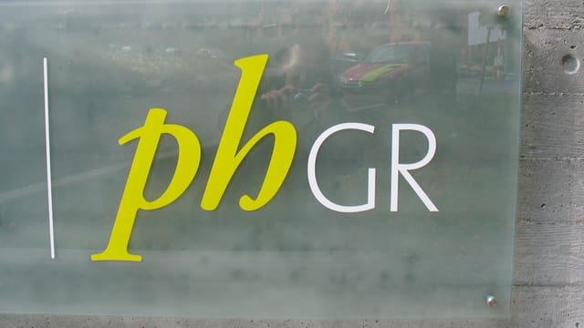 Il logo da la Scola auta da pedagogia dal Grischun.