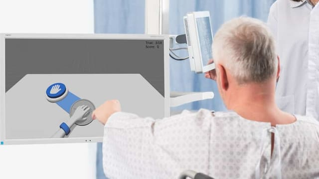 Ein Mann im Rollstuhl verschiebt einen Puck auf einem Bildschirm.