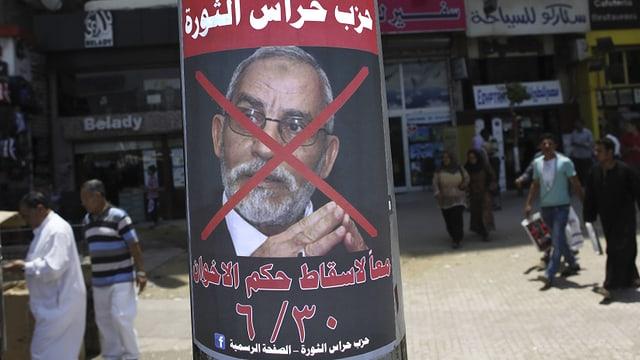 Ein Plakat mit dem Konterfei Mohammed Badies.