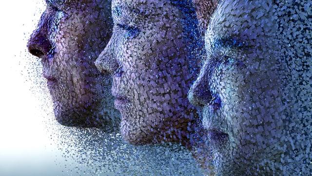 Drei aus blau-violetten Teilchen zusammengesetzte Gesichter.