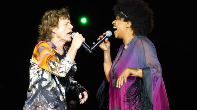 Lisa Fischer und Mike Jagger singen