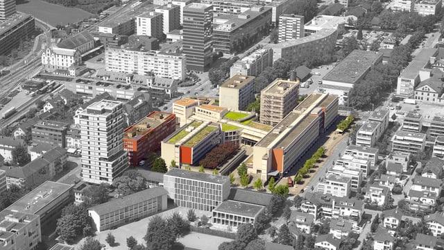 Eine Luftaufnahme des Guthirt-Quartier mit Einfamilienhäusern, Industriebauten und Hochhäusern.