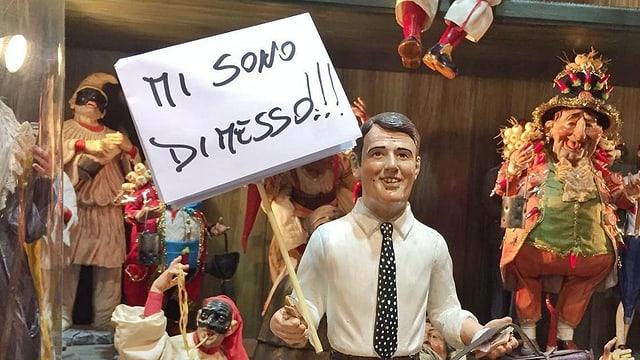 Ina figura da Matteo Renzi cun il placat «Jau demissiunesch».