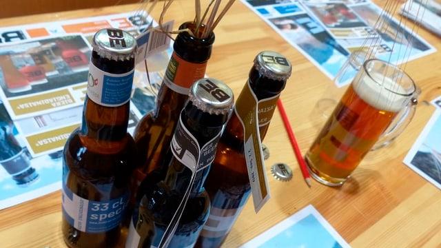 Pliras buttiglias da biera da Tschlin