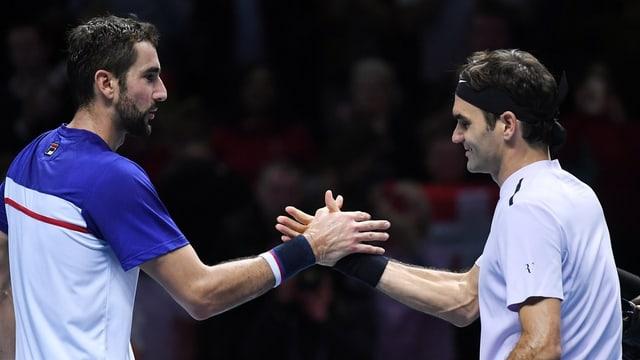 Federer e Cilic dattan il man suenter il gieu.