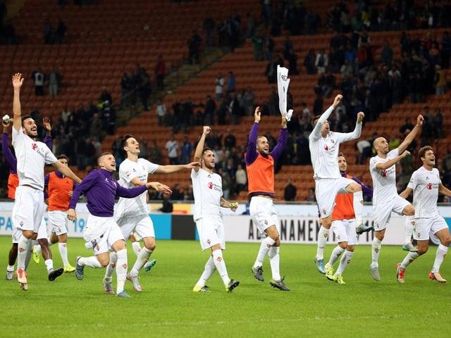 Jubelnde Fiorentina-Spieler.