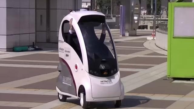 Ein Ein-Mann-Auto in einem Vorführvideo.