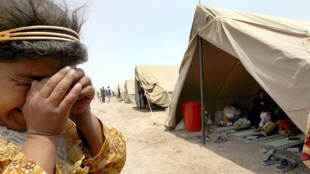 Weinendes Kind in einem Flüchtlingslager im Irak, Juli 2014.