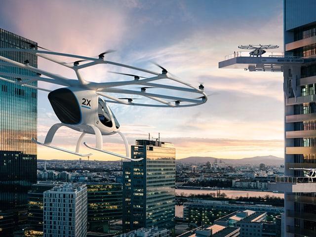 Zwei Volocopter zwischen Hochhäusern.