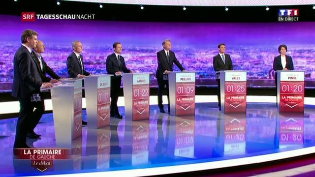 7 politichers da la Frantscha sin ina tribuna en in studio da televisiun