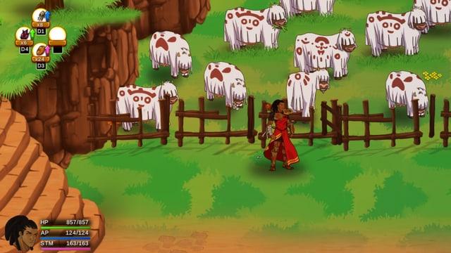 Kühe auf einer Weide in mit Symbolen bemalten weissen Umhängen.