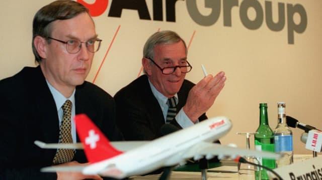 Bruggisser und Goetz bei einer Medienkonferenz.