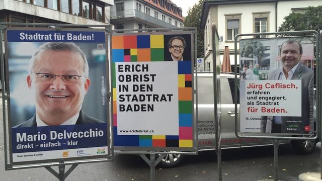 Plakate von allen drei Kandidaten in Baden.