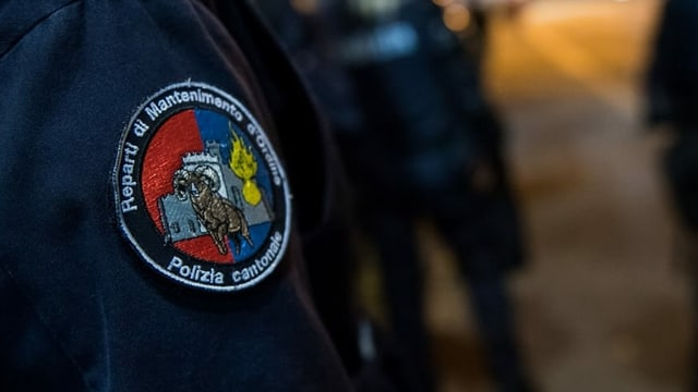 purtret d'in badge d'in policist chantunal
