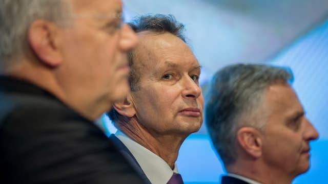 Johann Schneider-Ammann, Philipp Müller, und Didier Burkhalter im Porträt.