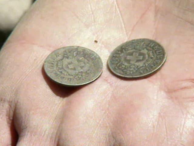 eine Münze von 1850 und ein Fälschung von Farinet
