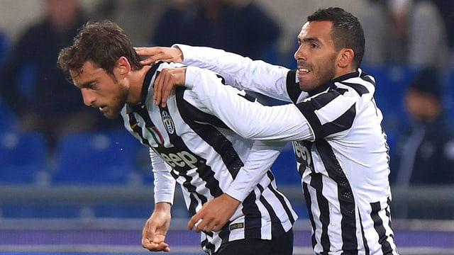 Carlos Tevez (rechts) und Claudio Marchisio streben gegen Atletico einen Sieg an.
