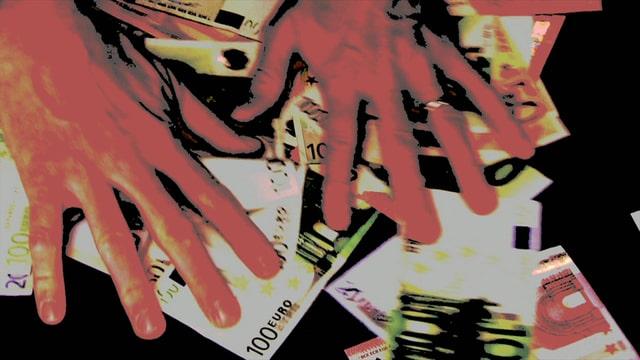 Hände greifen nach Euro-Scheinen.