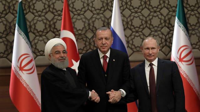 Hassan Rouhani, Vladimir Putin e Recep Tayyip Erdogan.