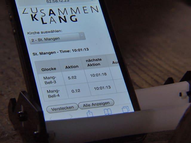 Smartphone mit der App «Zusammenklang» mit der Zeitsteuerung.