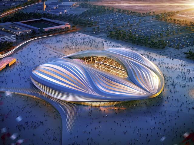 Ein futuristisch anmutendes, erleuchtetes Stadion in Blautönen, fotografiert aus Vogelperspektive.