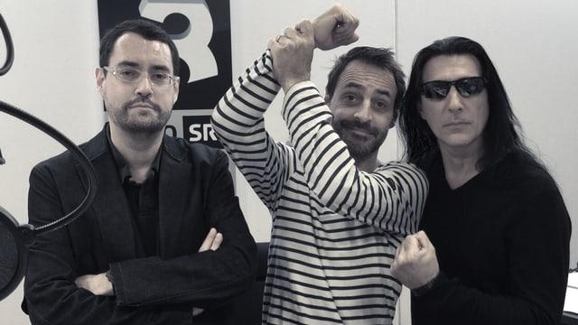 Schriftsteller Gion Mathias Cavelty, Rock-Special-Moderator Dominic Dillier und Manowar-Chef Joey DeMaio (von links).