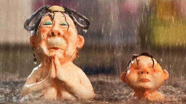 Illu: Zwei Männer im Regen, der eine hat die Hände gefaltet.